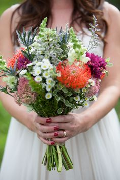 Colorful wildflower bridal bouquet idea {Laura Hollander Photography}