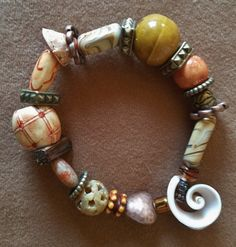 Stretch Bracelet, Lg & Small Mix of Unique Beads-- Glass, Metal, Paper, Seashell, Porcelain,Wood, Stone and Lampwork by SerendipitysRarities on Etsy