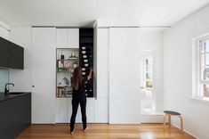 Small Space Hacks: Sliding Cabinet Doors Hide Clutter - Fine & Home Tiny Apartments, Tiny Spaces, Small Rooms, Sliding Cabinet Doors, Design Minimalista, Small Apartment Design, Studio Apartment, Small Space Kitchen, City Living