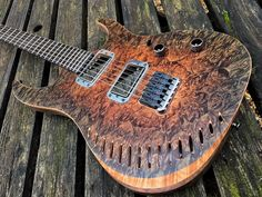 """Sabre Guitars 1. Ghost Private stock HBH-6 Master Walnut body private stock walnut burl top. Fully hollow with slash cut sound holes. Raptor burst oil-wax finish Rosewood/maple 5pc neck Modern Flat D profile Private stock ebony fretboard 16"""" radius 24 fret 25.5"""" scale Body matched headstock Hannes bridge Gotoh tuners Sabre Ultra III humbuckers."""