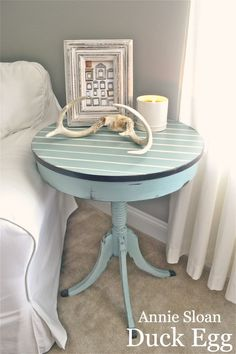 the aqua table is amazing with the gray and white that surrounds it.
