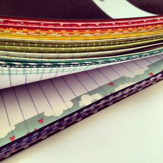 DIY personalized notebook! washi tape on the edges of the paper, done and done