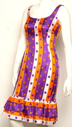 1960s Mod Wiggle Dress.  I had one of these.  White and orange daisies.