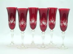 $43.95-$55.00 6 Piece Champagne-flute Glass Set in Crystal Blue with White Etchings - The Imported Gift Depot presents the unique champagne-flute glass set in vivid red  with the clear etching motif. Each glass has been designed in vibrant red and complimented with the vivacious clear etching for maximum effect.  This set of 6 holds 11 ounces and measures 9 inches in height. It is a truly one-of ...
