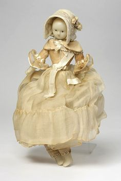 must have belonged to some one on the wealthy side, its so finely made! Doll, possibly dressed as bride (England) ca. 1830s poured wax, satin, silk gauze, ribbon, woven straw, silk net