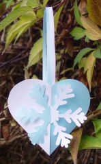 "These hearts with snowflakes are made just as described for ""Joined Hearts"". To make the hearts prettier glue stick the small joined heart to cover the low parts of the handles. Now the…"