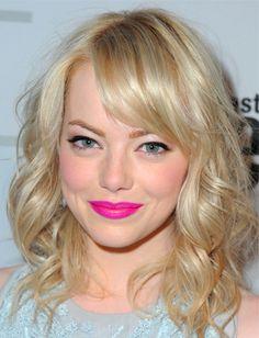 Blonde beauty with a fierce pink pucker