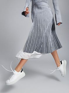 """The Designer: Brooklyn-based Ryan Babenzien has been in the sneaker game for years (previously at Puma and KSWISS). He owns at least eighty pairs. This season it's about: Previously, women would beg the menswear-only label to design in smaller sizes. Now, the sell-out sneakers make their global womenswear debut on M'O. Crafted in Italy, they are minimal, sleek and incredibly comfy…meet your new """"most adaptable"""" shoe. The piece to buy: The silver metallic, exclusive to Moda."""