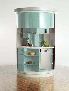 "Taking up just 20 square feet, this circle kitchen promises to ""rotate up to 180 degrees to give you a sink, microwave, and dishwasher"" along with ""the same amount of kitchen cupboard as any other middle-sized kitchen."" Sounds kind of crazy, right?"