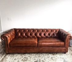 With its sheltering arms and deeply tufted upholstery, the Chesterfield Sofa is synonymous with comfort. Our leather sofa retains all the fine points of the Edwardian originals, creating furniture that's perfect for relaxing. Tufted Leather Sofa, Tufted Sofa, Leather Furniture, Leather Chesterfield, Leather Couches, Couch Sofa, Sofa Set, Home Decor Furniture, Sofa Furniture