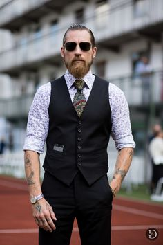 Justin OShea in his uniform fitted vest. In Copenhagen | More outfits like this on the Stylekick app! Download at http://app.stylekick.com