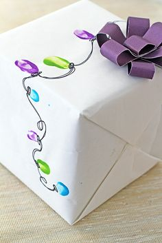 Fingerprint Christmas Light Wrap. Could do any fingerprint art for other gifting occasions on white-colored wrapping paper
