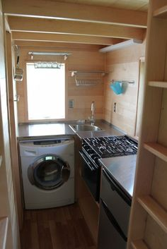 Tiny house kitchen/laundry....stainless steal and wood