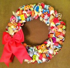 Lalaloopsy Minis are the perfect size for using in birthday party decorations. Ribbon and buttons were used along with Lalaloopsy Mini dolls to create this festive wreath to greet birthday party guests.