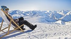 Panorama of a girl sunbathing in a deckchair near a snowy ski slope Stock Photo , Skier, Der Bus, Ski Slopes, Stock Image, Mount Everest, Tours, Stock Photos, Panorama, Travel