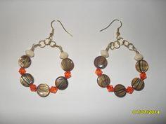 Brown, orange and cream beaded hoop earrings.
