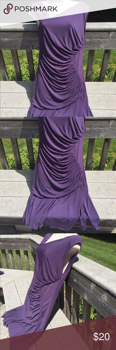 "Plum Dress Half of the brand name is covered with a tiny sticker with a bar code the second part says tribe (any guesses on brand )  95% polyester 5% spandex . Length is about 38""  under the arms across laying flat is 15"" Something then tribe Dresses"