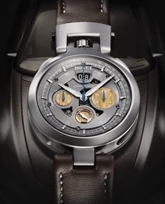 """Cambiano Cambiano. The Amadeo® system, which can be found on all Fleurier and BOVET by Pininfarina collections, allows owners to convert their timepiece into a wristwatch, a miniature table clock or a pocket watch without the need for any tools whatsoever. The centre console of the """"concept car"""" is equipped with a housing in which the timepiece can be secured. It takes only a few seconds to convert the dashboard clock into a wristwatch. @calibrelondon"""