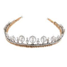 An Edwardian platinum diamond tiara. Of garland design,