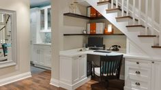 If you don't have room for a separate office, you might be able to reclaim the unused space under a staircase, as this elegant, built-in workspace does.