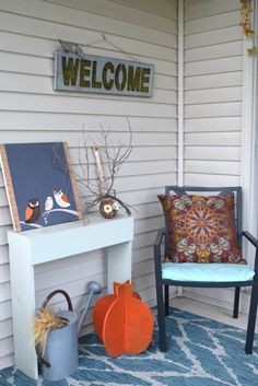 outdoor furniture ideas for a cozy fall. fall front porch decor ideas, keeping things simple and traditional with pumpkins and bright fall colors. Easy ideas and DIY projects to decorate a home on any budget!