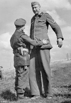 David ans Goliath. The moment Bob Roberts disarmed a Jakob Nacken, a giant German soldier in Normandy. Bob landed on D-Day at Juno Beach.