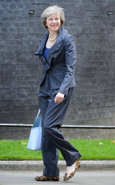 At the 2002 Tory conference, Theresa May caught the nation's attention with a speech reprimanding her colleagues for their reputation as 'the nasty party' - and her leopard-print kitten heels. Theresa May, Pride Of Britain, Fancy Shoes, Politicians, Role Models, Love Fashion, Work Wear, Jumpsuit, Female