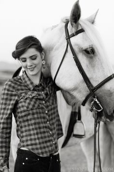 A fitted plaid shirt is this fall's chicest accessory. #ruche #shopruche #equestrian