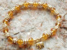 Check out this item in my Etsy shop https://www.etsy.com/uk/listing/398567179/autumn-gold-bracelet-lucky-elephant