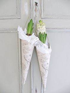 ~ May Day baskets possibilty - oooo - with forced bulbs  (maybe pebbles and dirt below; instructions?). Lace doily. parchement cone/string.  yes