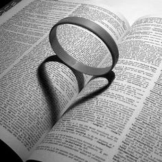 It would be cool if this ring were resting on a Bible......unending circle of sacraficial love manifested through the word of God.