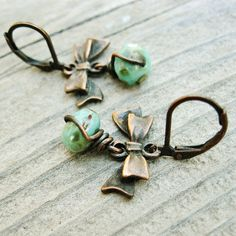 Aqua Czech Picasso Glass Rondelles and Antiqued Copper Bows dangle earrings by BearRunOriginals on Etsy,