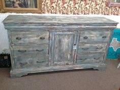 $285 - This is a rustic 6 drawer console with a center cabinet with shelving. Painted with shades of turquoise chipping paint, distressed and finished with a dark wax. ***** In Booth C1 at Main Street Antique Mall 7260 E Main St (east of Power RD on MAIN STREET) Mesa Az 85207 **** Open 7 days a week 10:00AM-5:30PM **** Call for more information 480 924 1122 **** We Accept cash, debit, VISA, Mastercard, Discover or American Express