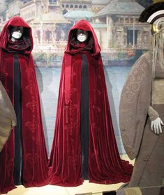 These crimson velvet cloaks, printed down the front of the crest of Naboo, are one of several worn by Queen Amidalas handmaidens in Star Wars Episode I.