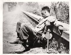 1944- Soldier with the U.S. 36th Engineers asleep on the roadside outside Velletri, Italy. Pin by Paolo Marzioli