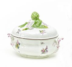 Lidded Tureen with Artichoke Pommel.   Meissen. Circa 1750/60.     Porcelain, enriched in colours. Oval form with acanthus handles and Gotzkowsky mouldings. Large, three-dimensional pommel with rocailles and an artichoke. Outer surface with flower bouquets. Height 24cm, length 31cm.   Crossed swords mark.