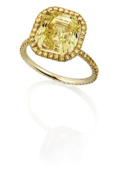 LEVIEV Fancy Vivid Yellow Diamond Ring totaling 5.80 carats, handcrafted in 18 karat yellow gold.