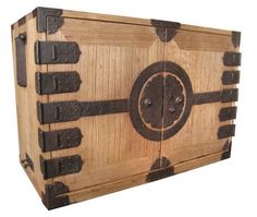 Japanese kannon biraki tansu (chest with opening doors), all kiri (paulownia) wood with heavy iron hardware including a large round encircled blossom mon as the central lock plate; Edo Period