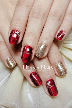 Red and black plaid mani with rhinestones and gold glitter accent nails
