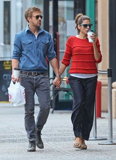 While strolling the NYC streets with Ryan Gosling, Eva Mendes donned a comfy-slash-chic outfit — red Boy by Band of Outsiders sweater and navy trousers — with her tried-and-true Stuart Weitzman espadrilles and funky Thierry Lasry shades.