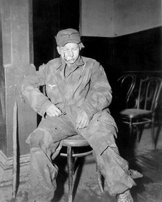 "A teenage German flak gunner is captured by the U.S. 104th Infantry ""Timberwolf"" Division in the Weisweiler municipal hall. Eschweiler, Aachen, North Rhine-Westphalia, Germany. November 1944."