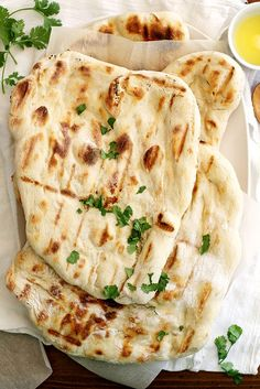Breathtaking NO KNEAD Grilled Naan from  @girlversusdough. Doesn't get much better than that! Easy, delicious and pairs perfectly with hummus!