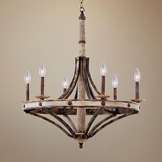 Add rustic charm to home interiors with this stylish Florence gold finish, wrought iron 6-light chandelier, from Kalco.