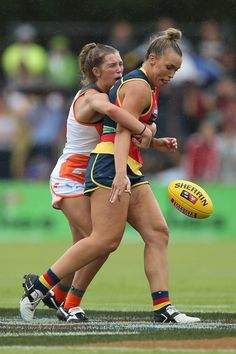 Abbey Holmes Photos Photos - Maddy Collier of the Giants tackles Abbey Holmes of the Crows during the 2017 AFLW Round 01 match between the Adelaide Crows and the GWS Giants at Thebarton Oval on February 4, 2017 in Adelaide, Australia. - AFL Women's Rd 1 - Adelaide v GWS
