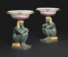 c1805-15 A PAIR OF FRENCH PORCELAIN EGYPTIAN FIGURE CENTREPIECE BASKETS  CIRCA 1805-15, INCISED LETTERS AND NUMERALS  Price realised GBP 17,500