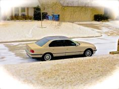 A cold, snowy day in March, 2014, for my '98  E38 with a black-wrapped roof.