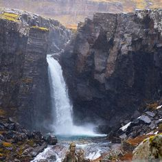 """""""You see waterfalls everywhere in Iceland, just right there off the road. I would have liked to get closer to this one, but as you might be able to see from the picture, it was pouring!"""" Photo taken by @ienjoyhiking on Instagram, pinned via the InstaPin iOS App! http://www.instapinapp.com (06/23/2015)"""