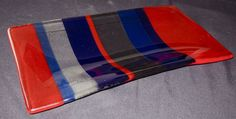 "Complementary stripes in Blue & Orange. 12"" x 6"" slumped plate."