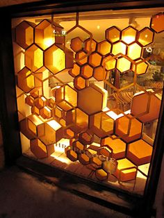 Store front windows - Playing with golden honeycombs and hexagonal design – Store front windows Shop Window Displays, Store Displays, Retail Displays, Display Window, Display Design, Store Design, Design Design, Wall Design, Display Ideas