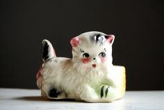 Vintage Planter - Playful Kitten With Ball - American Bisque - 1950s.  via Etsy.